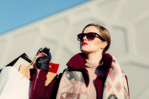 fashionable woman in fur and sun glasses
