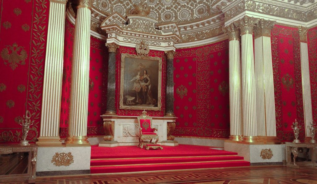 throne in a red cathedral room